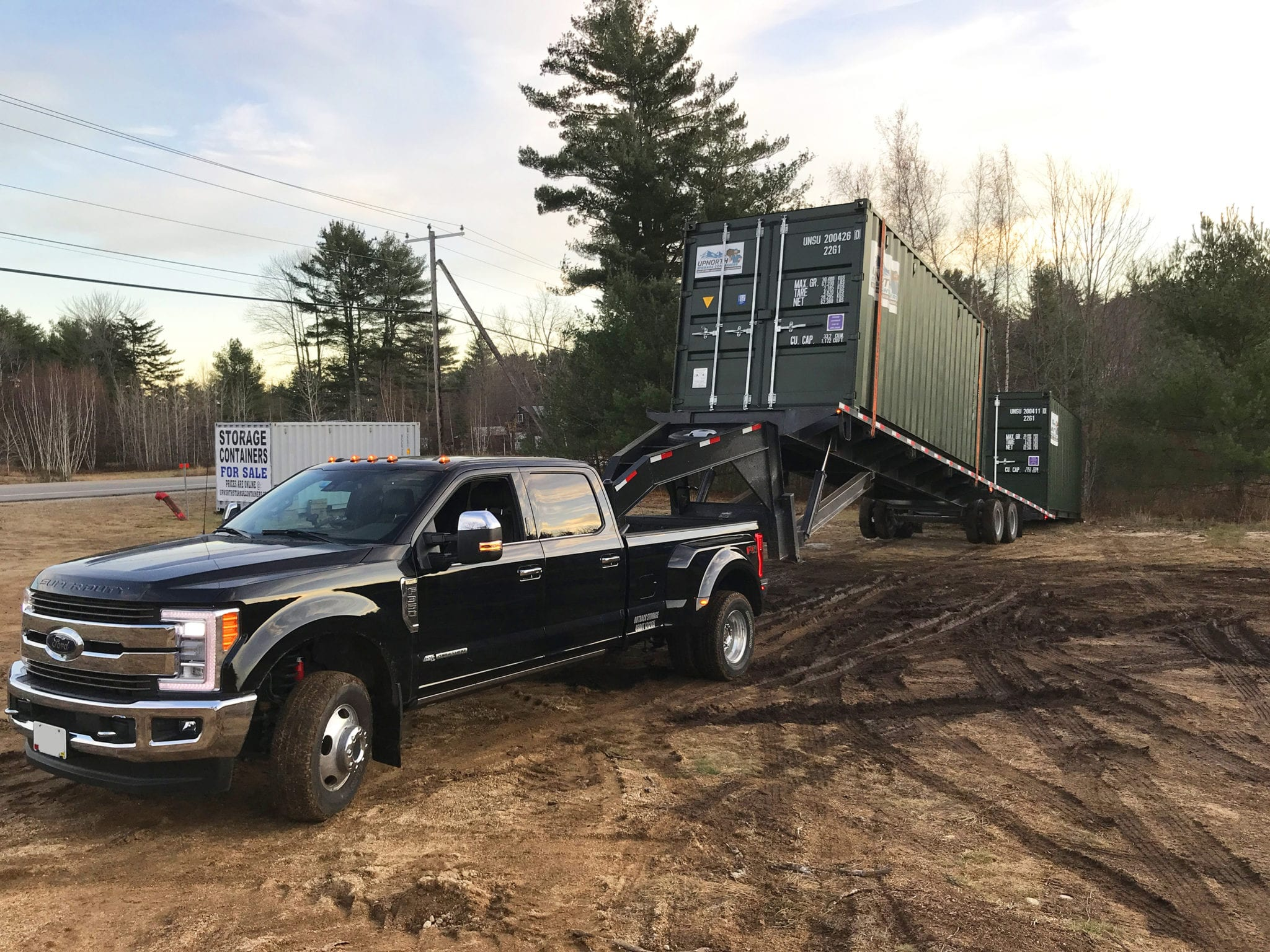 Truck delivering a shipping container in New Hampshire.