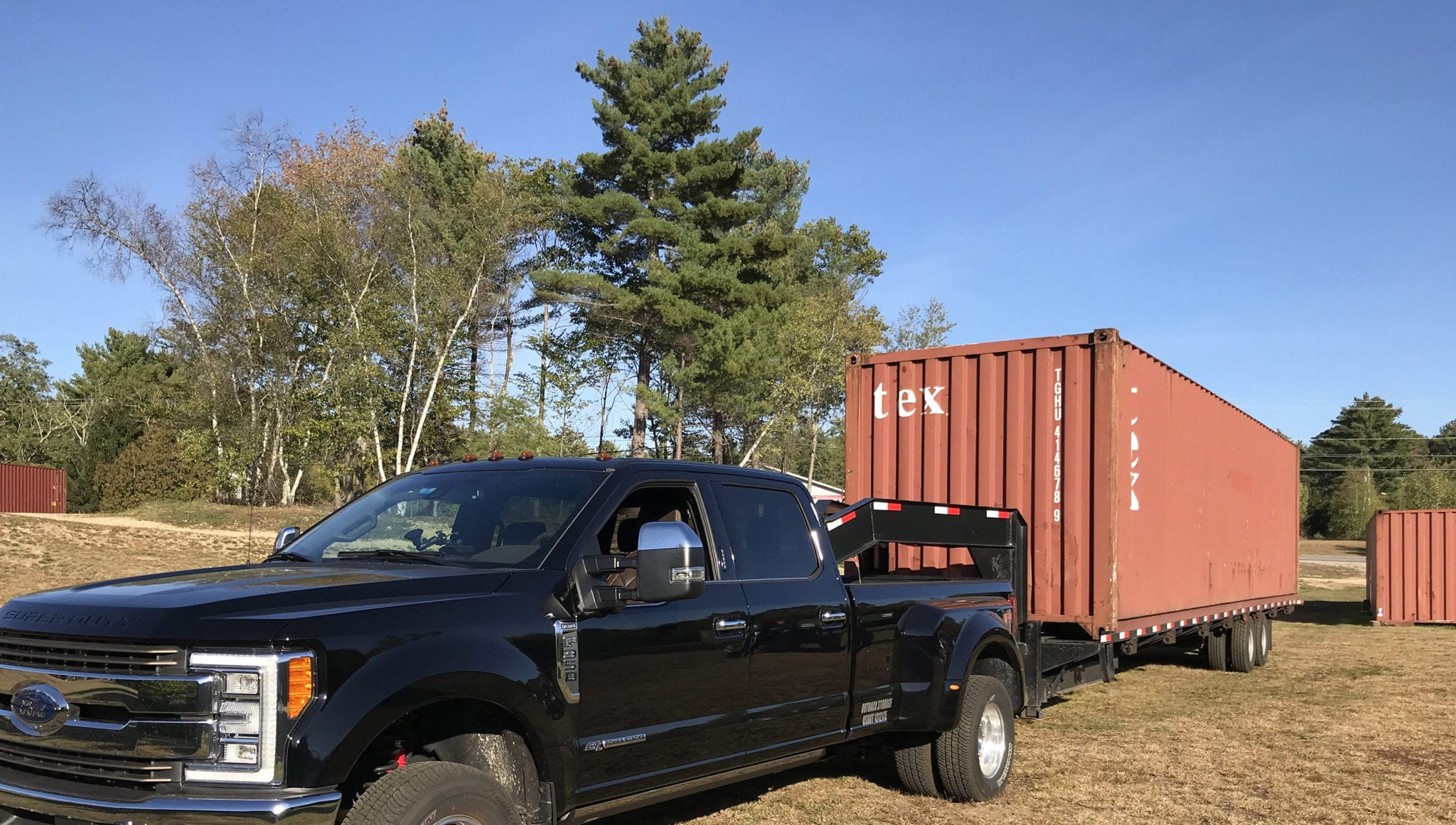 Truck delivering a storage container in New Hampshire.